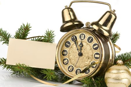 New Year's decoration with an antique clock and a firtree branch and a blank card for your text Stock Photo - 5850167