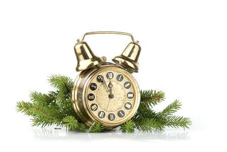 New Year concept. Alarm clock and conifer branch photo
