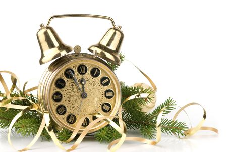 New Year concept. Alarm clock and fir-tree branch photo