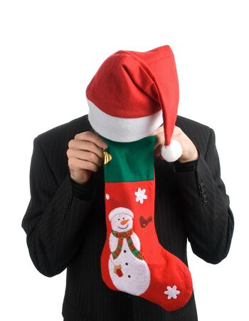white stockings: business man in a christmas hat with a Christmas Stocking Stock Photo