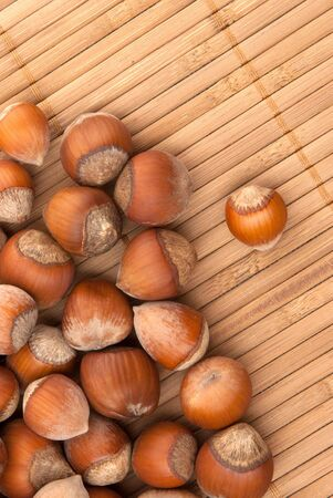 nutshells: many brown hazelnuts with hard nutshells Stock Photo