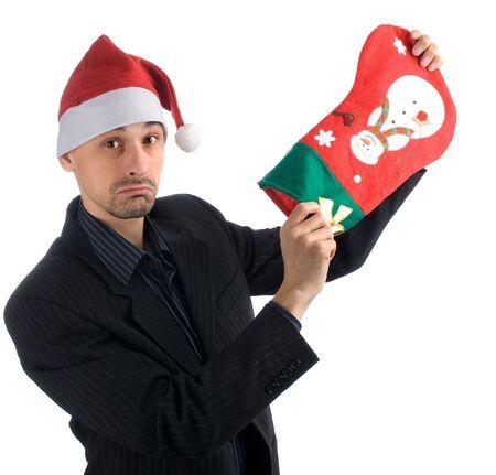 desilusion: hombre de negocios en un sombrero de Navidad con un Stocking de Navidad