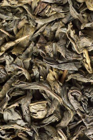 Background of green tea leaves close-up Stock Photo - 6075277
