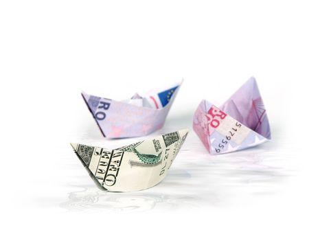 Ships made of money in water Stock Photo - 6153197