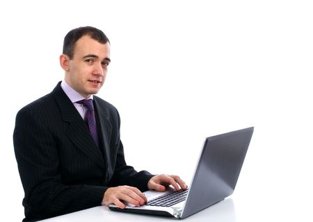 businessman working at his computer: Businessman working on his laptop computer Stock Photo
