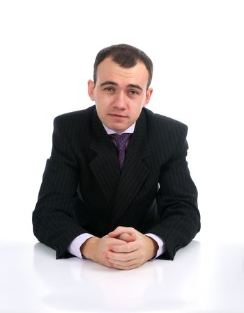 Young serious businessman Sitting at Desk photo