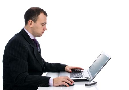 Businessman working on laptop computer. Isolated over white photo