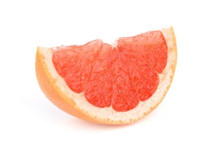 Slice of grapefruit isolated over white background photo