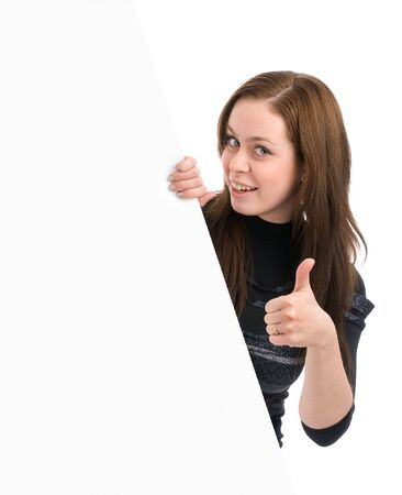 Happy beautiful smiling woman looks out from of the banner and showing thumbs-up Stock Photo - 6516635