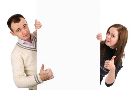 young couple presenting a blank board over white background Stock Photo - 6600064