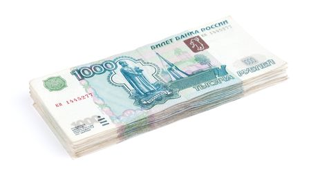 encash: Pile of rouble banknotes on a white background Stock Photo