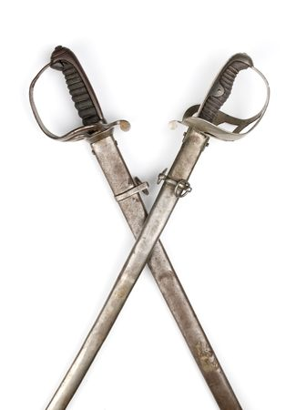 crossed: two crossed ancient sabers isolated over white Stock Photo