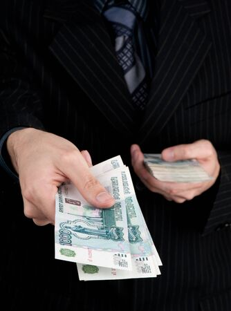 roubles: Hand holding boundle of roubles