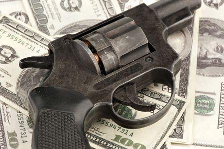 stealing money: gun and money Stock Photo