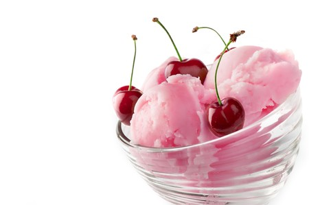 Fruit ice cream with cherry isolated on a white background