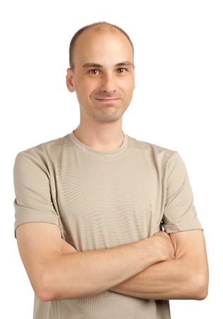 Smiling young casual man looking at camera photo