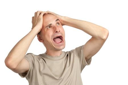 panique: crier choqu� jeune homme isol� sur un blanc.