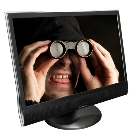 Funny man with binocular in a computer monitor photo