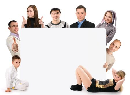 Group of young people holding a blank board  photo