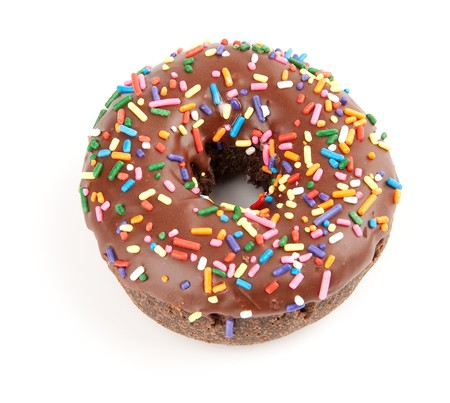 Donut with chocolate icing and colorful sprinkles photo