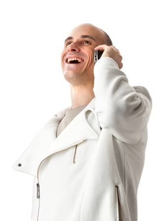 casual man smiling and talking on a mobile phone isolated over a white background photo