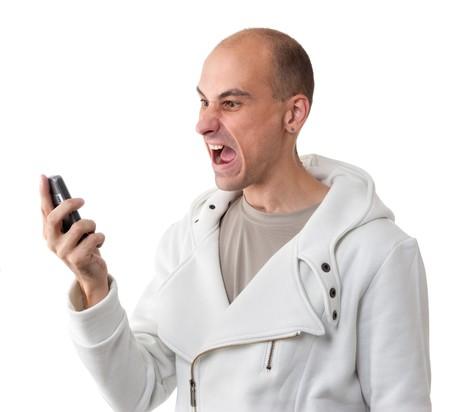 bald ugly: angry man shouting at the phone