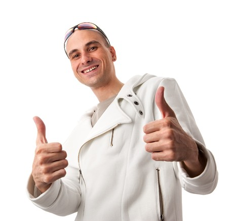 Happy casual young man showing thumb up and smiling isolated on white background  photo