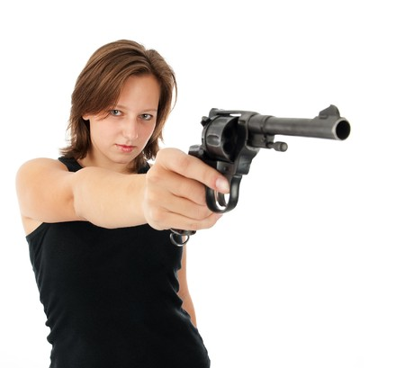 young woman with a gun isolated on white  Stock Photo - 7984926