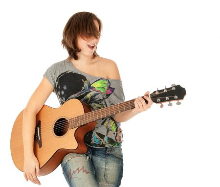 Teenager girl playing an acoustic guitar, isolated on white photo