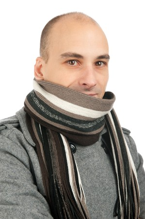 Attractive male wearing a coat and scarf photo
