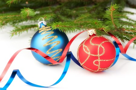 Christmas baubles with curly ribbon and christmas tree on a white background Stock Photo - 8036581