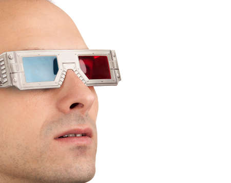 Young man watching television in 3D wearing red and blue glasses  Stock Photo - 8036599