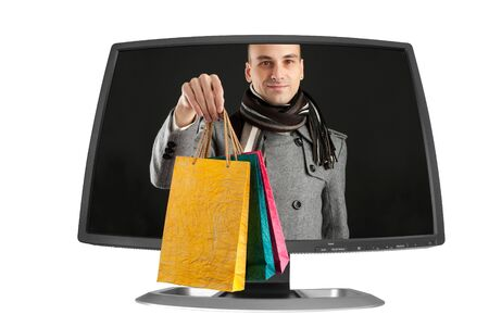 young man with paper bags in a computer monitor photo
