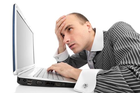 Worried businessman with computer isolated on white photo