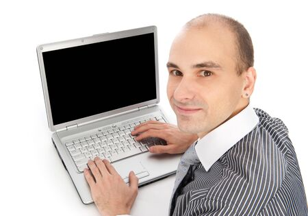 looking at computer screen: Portrait of a young businessman using laptop