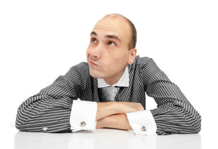 Portrait of handsome young thoughtful businessman photo