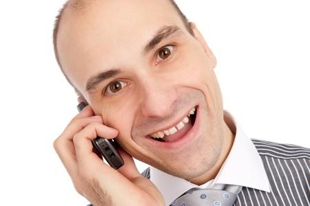 businessman talking on mobile phone. Isolated on white.  photo