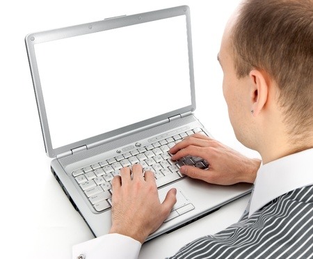 Rear view of a young man working of a laptop