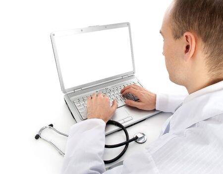 docs: Rear view of a young doctor with laptop Stock Photo