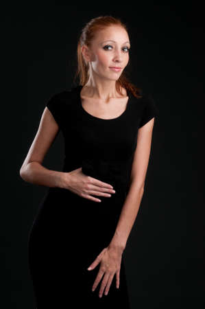 Portrait of the beautiful woman. Dark background Stock Photo - 8333456