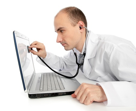 laptop repair: Doctor with stethoscope fixing laptop Stock Photo