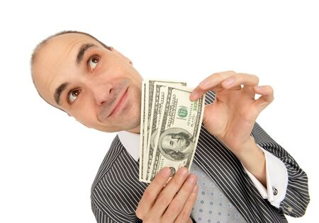 corporate greed: Businessman Holding Money isolated on white