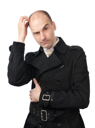 baffle: Young businessman scratches his head in confusion Stock Photo