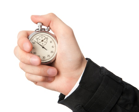 Stopwatch in a hand isolated on white background Stock Photo