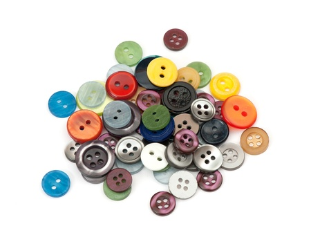 heap of various buttons on white background photo