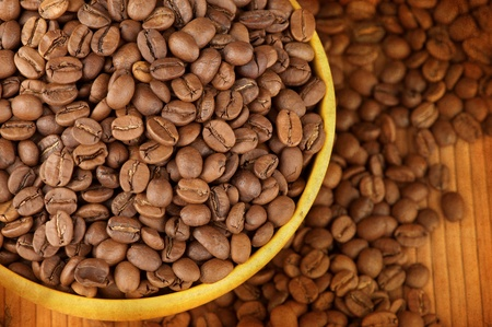 Macro studio shot of a cup of coffee beans photo