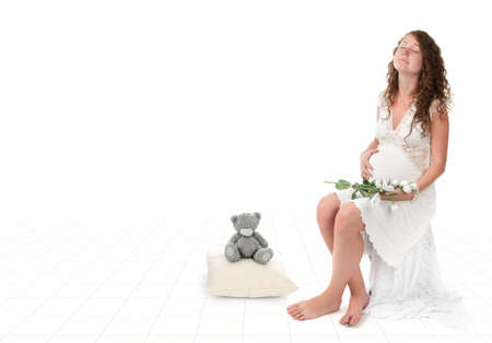 pregnant woman caressing her belly over white background Stock Photo - 9957707