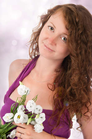 Beautiful woman with flowers isolated on white photo