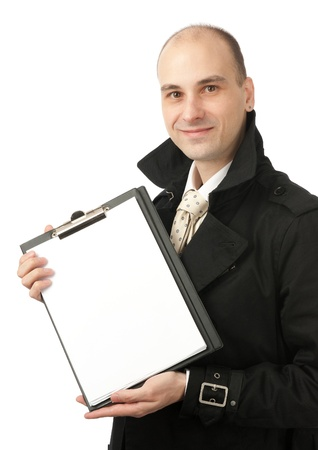 Happy smiling businessman holds a blank paper sheet photo