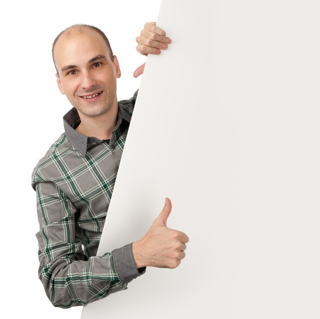 smiling young handsome man with blank banner Stock Photo - 10843934